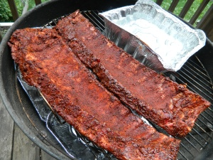 The rubbed ribs go on the grill after two hours with the dry marinade.
