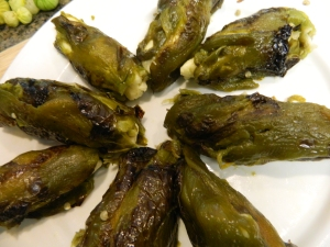 The poblanos have now been stuffed with the little cheese torpedos.